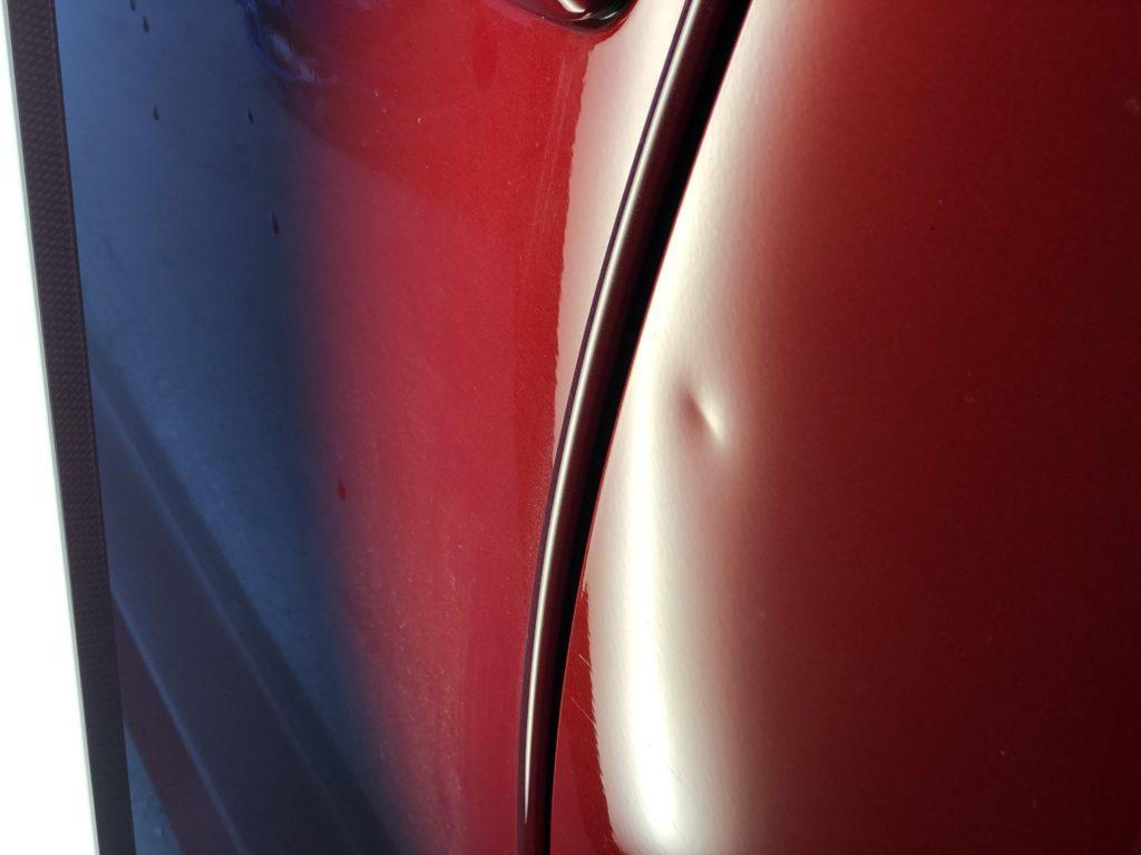 トヨタ カローラスポーツ ドアのデントリペア作業前